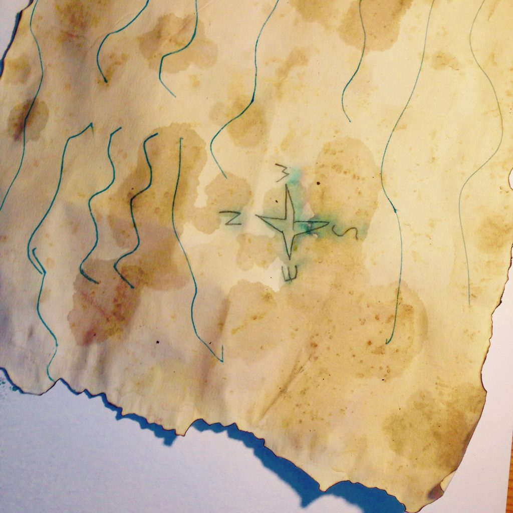 Splash additional patches of tea onto the paper for an uneven finish.