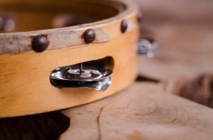 a picture of a tambourine. simple percussion instruments can be a great way to coordinate your class.