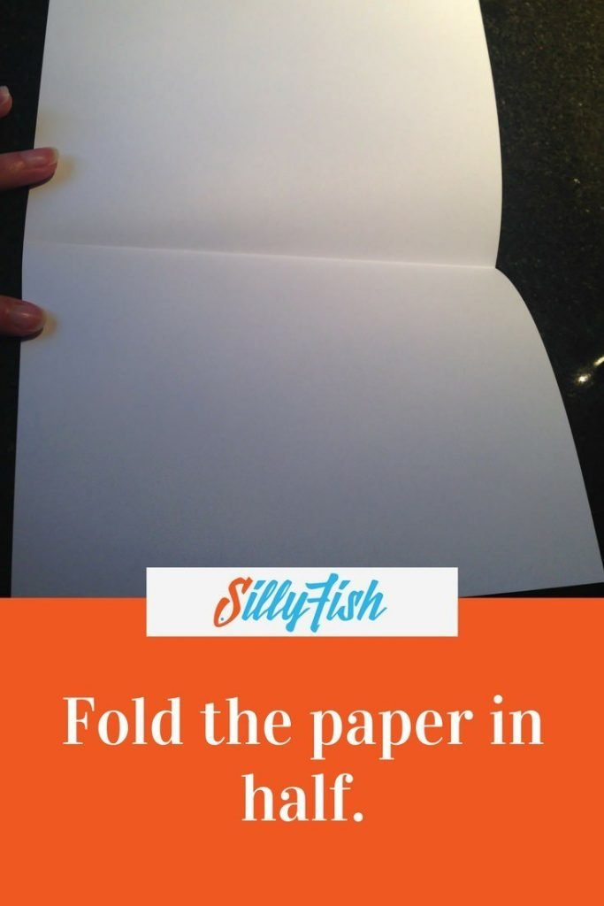 You can start creating your Ferocious Fish by folding a piece of A4 paper in half.