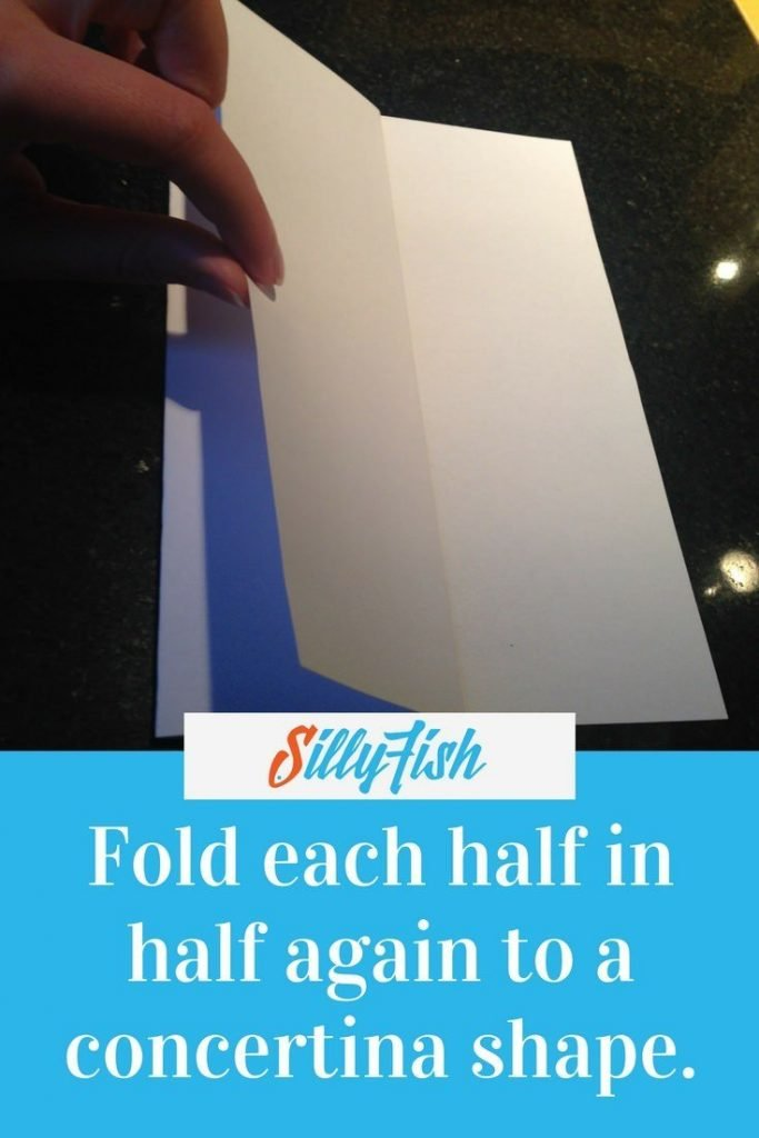 Fold each half of your A4 paper in half again to create a concertina shape. This will form the base for your Ferocious Fish.