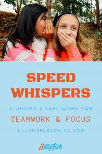 Two girls whispering. Speed whispers is a drama game in which students must whosper a phrase to eachother in teams. It improves teamwork, focus, pronunciation and is an effective TEFL activity.