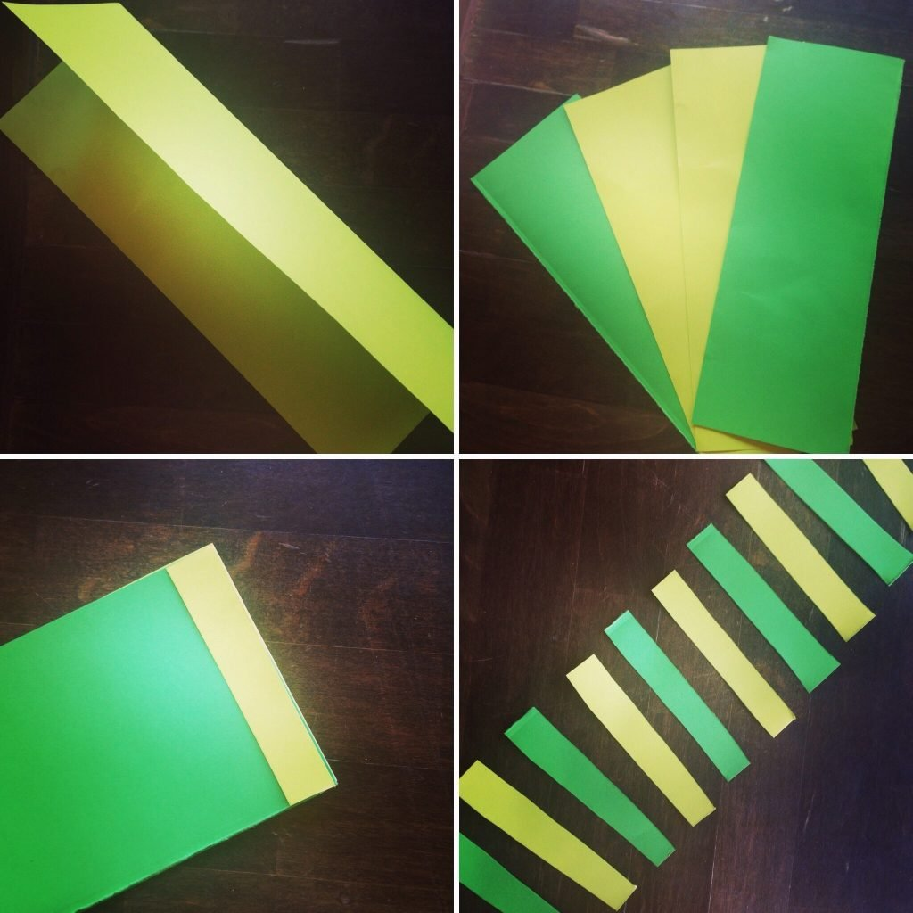 Fold and cut the paper in half. Cut the paper into strips of equal width.