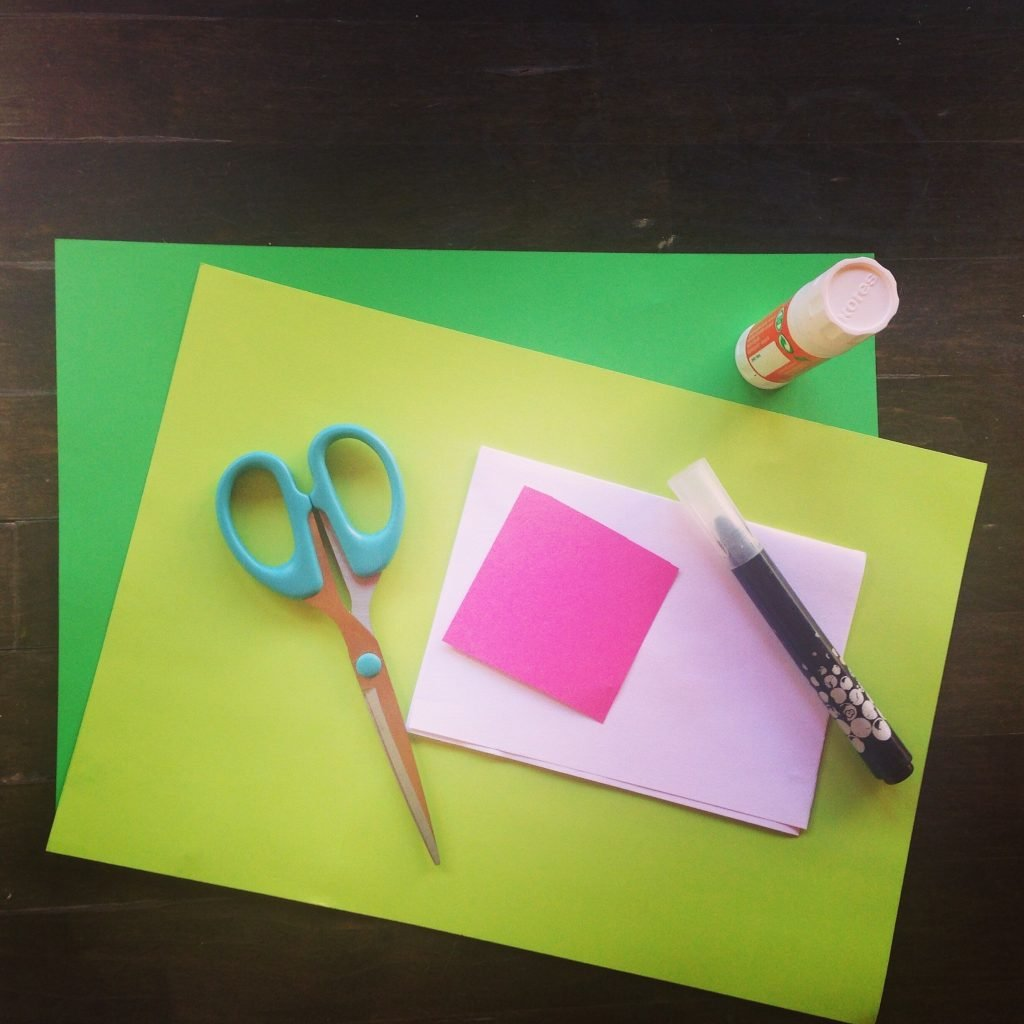 You will need coloured card, scissors, glue and a black pen.
