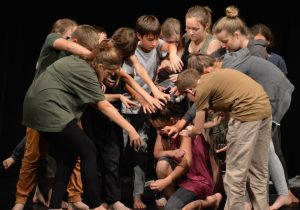 Prague Youth Theatre Seniors (11-12 years) devising a movement sequence.