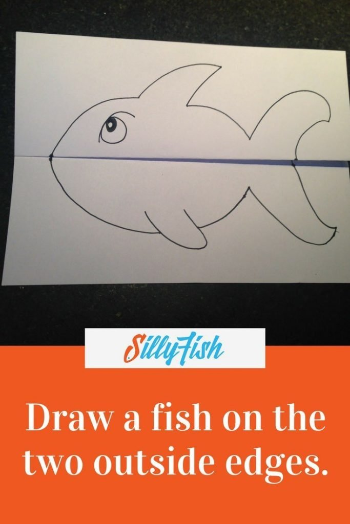 On the outside panels of your A4 concertina paper, draw a fish.