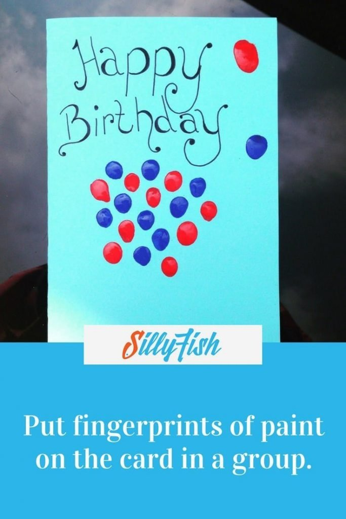 Put fingerprints of paint on the card in a group.
